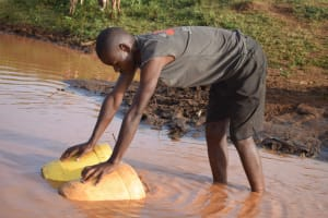 The Water Project: Kangalu Community -  Filling Container With Water