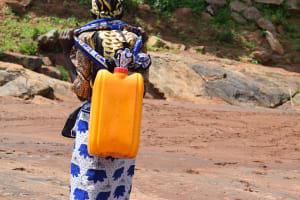 The Water Project: Maluvyu Community G -  Hauling Water