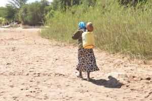 The Water Project: Mukuku Community A -  Returning Home With Water
