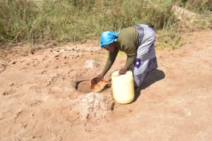 The Water Project: Mukuku Community A -  Scooping Water