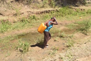 The Water Project: Kaukuswi Community A -  Carrying Water Home