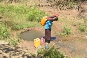 The Water Project: Kaukuswi Community A -  Carrying Water