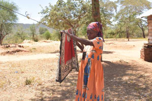 The Water Project: Kaukuswi Community A -  Hanging Clothes On The Line