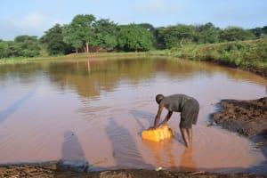 The Water Project: Kangalu Community A -  Fetching Water