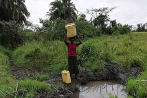 The Water Project: Nyakasenyi Byebega Community -  Carrying Water