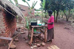 The Water Project: Nyakasenyi Byebega Community -  Placing Dishes On Rack