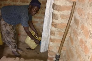 The Water Project: Nyakasenyi Byebega Community -  Pouring Cup Of Water