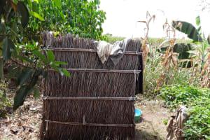 The Water Project: Kimigi Kyamatama Community -  Bathing Shelter