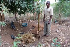 The Water Project: Kimigi Kyamatama Community -  Busingye At His Refuse Pit