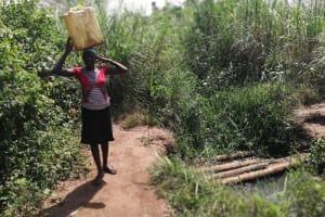 The Water Project: Kimigi Kyamatama Community -  Carrying Water