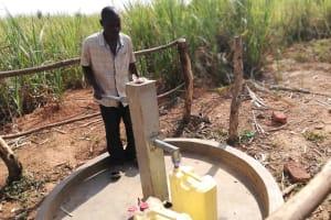 The Water Project: Kimigi Kyamatama Community -  Collecting Water