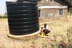 The Water Project: Kimigi Kyamatama Community -  Collecting Water From Rainwater Tank