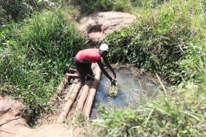 The Water Project: Kimigi Kyamatama Community -  Fetching Water