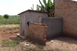 The Water Project: Kimigi Kyamatama Community -  Latrine And Bathing Shelter