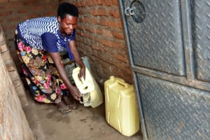 The Water Project: Kimigi Kyamatama Community -  Pouring Water For Drinking