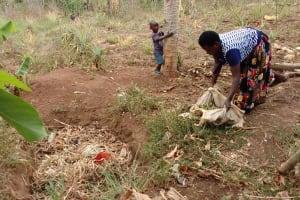The Water Project: Kimigi Kyamatama Community -  Throwing Away Trash