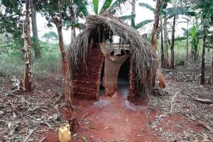 The Water Project: Kikube Nyabubale Community -  Latrine And Jug For Handwashing
