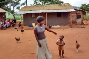 The Water Project: Kikube Nyabubale Community -  Mrs Lukana At Her Household Compound