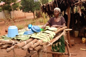 The Water Project: Kikube Nyabubale Community -  Placing Dishes On Rack To Dry