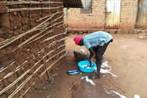 The Water Project: Kikube Nyabubale Community -  Washing Clothes