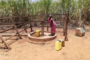 The Water Project:  A Woman Collectiong Water From Alternative Source