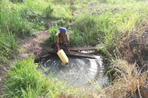 The Water Project:  Filling Container At An Open Source