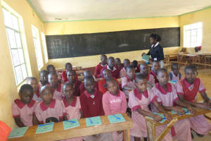 The Water Project: Irobo Primary School -  Passing Out Notebooks To The Students