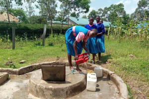 The Water Project: Kimangeti Primary School -  Getting Water From The Open Well