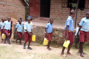 The Water Project: Kipchorwa Primary School -  Students With Water Containers