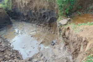 The Water Project: Musango Community, Ndalusia Spring -  Excavated Spring