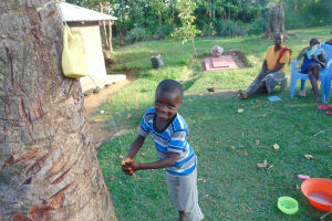 The Water Project: Musango Community, Ndalusia Spring -  Little Boy Using Leaky Tin