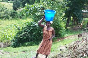 The Water Project: Buyangu Community, Osundwa Spring -  Joyce Carrying Water Home