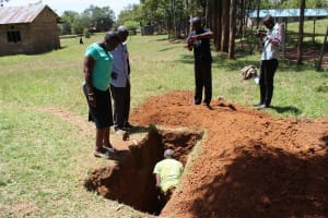 The Water Project: Khabukoshe Primary School -  Sinking The Latrine Pit