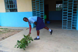 The Water Project: Musango Mixed Secondary School -  Sweeping With A Tree Branch