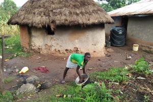 The Water Project: Sasala Community, Kasit Spring -  Washing A Pot