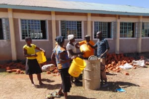 The Water Project: Musango Mixed Secondary School -  Community Members Delivering Water