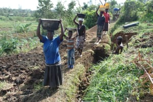 The Water Project: Musango Community, Mwichinga Spring -  Women Bringing Materials To The Site