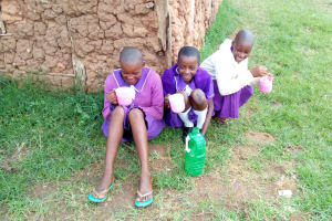 The Water Project: Chiliva Primary School -  Girls Drinking The Water