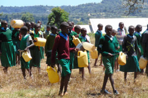 The Water Project: Bojonge Primary School -  Pupils Delivering Water To Mix Cement