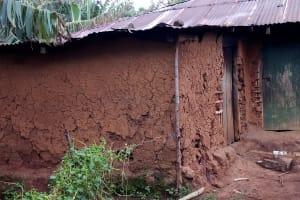 The Water Project: Bumira Community, Madegwa Spring -  Mud Home