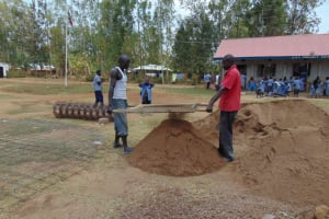 The Water Project: Matungu SDA Special School -  Sifting Sand To Be Used For Cement