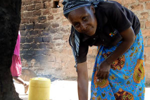 The Water Project: Kipchorwa Primary School -  School Cook Working Outside