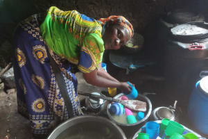 The Water Project: Kimangeti Primary School -  Cook Washing Drinking Cups