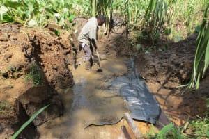 The Water Project: Mukangu Community, Lihungu Spring -  Foundation Construction