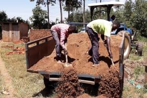 The Water Project: Bojonge Primary School -  Sand Delivering
