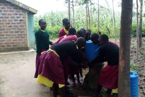 The Water Project: Nanganda Primary School -  Crowded Around A Handwashing Station