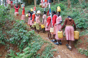 The Water Project: Kakamega Muslim Primary School -  Carrying Water