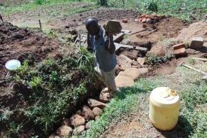 The Water Project: Musango Community, Mwichinga Spring -  Backfilling