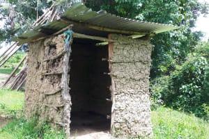 The Water Project: Buyangu Community, Osundwa Spring -  Mud Latrine