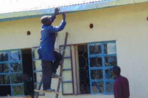 The Water Project: Bojonge Primary School -  Tito The Artisan Installing The Gutter System